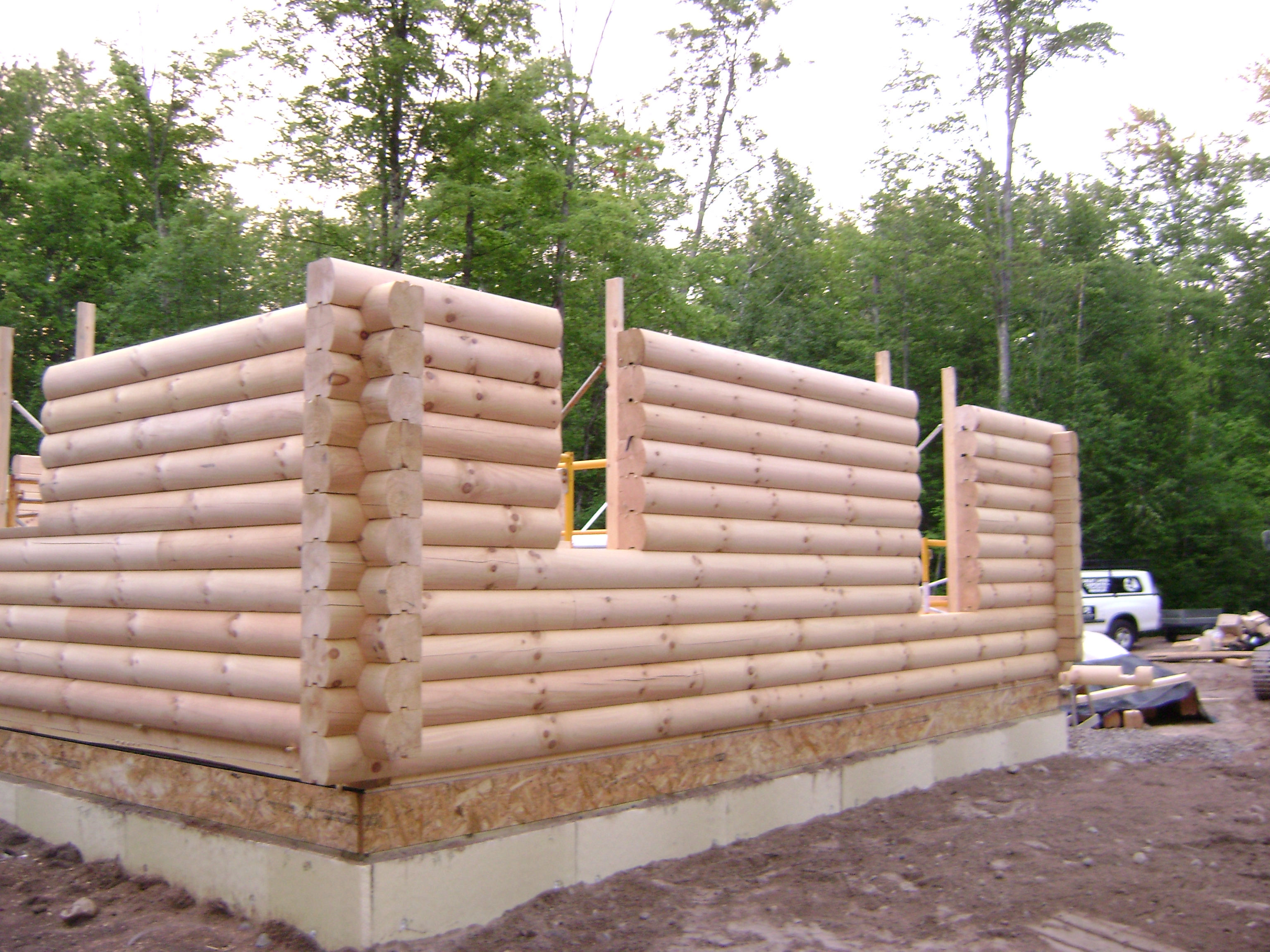 Construction and maintenance great lakes carpentry for Butt and pass log home